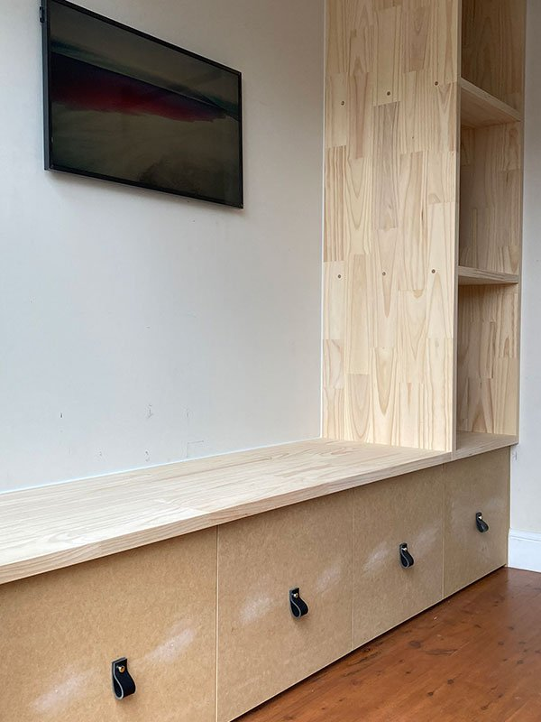 T.V cabinet with shelving and large storage draws to house kids school bags