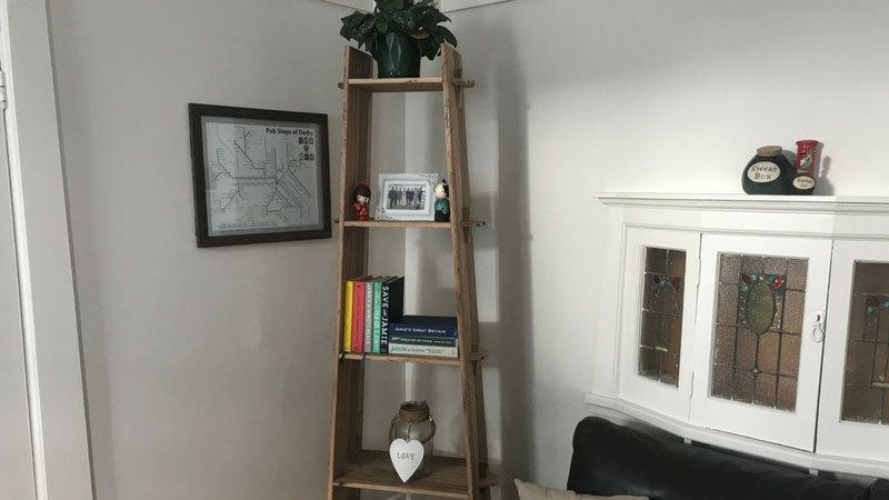 Commissioned hardwood corner stand.