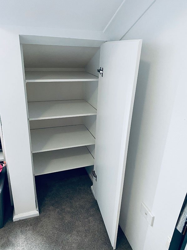 Simple but hidden away shelving storage of an unused space