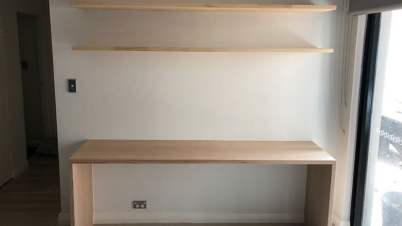 Custom built oak study nook with floating shelves