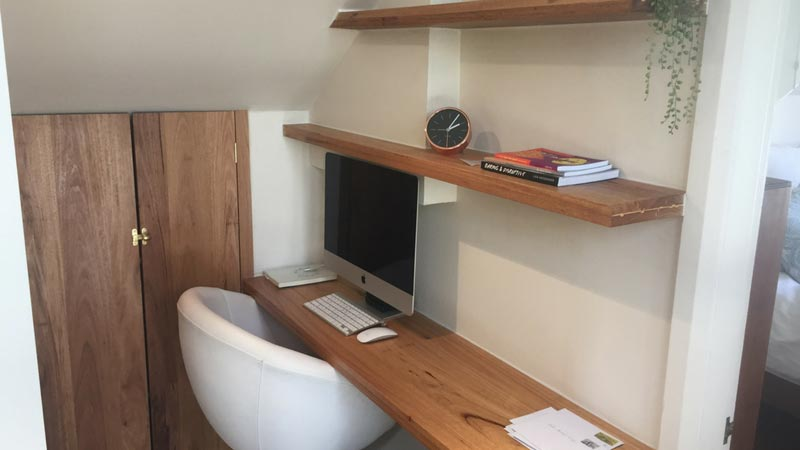 Bespoke Black Butt desk and shelving installed into a previously unused awkward space.
