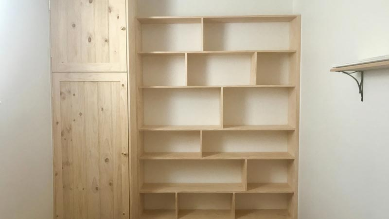 Custom built linen cupboard and book case.