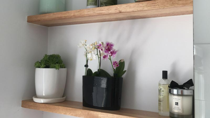Simple but stunning Oak floating shelves to further compliment the client's bathroom.