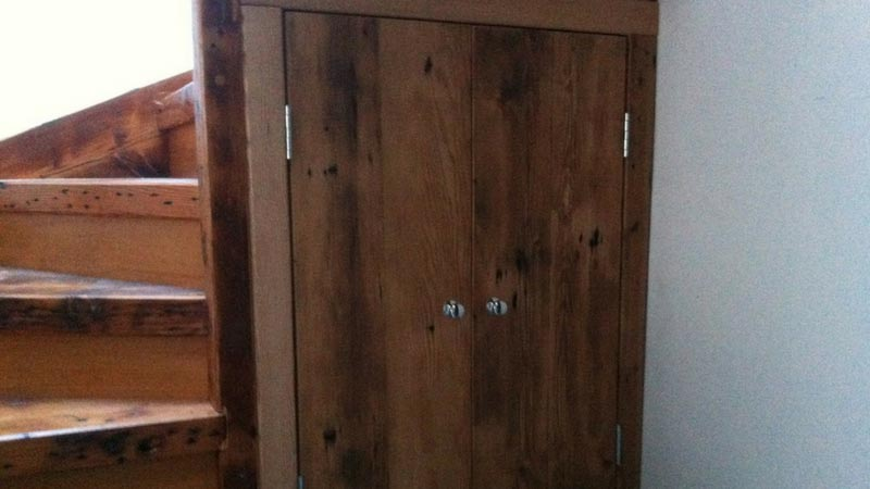 Custom built reclaimed Oregon under stair storage doors.