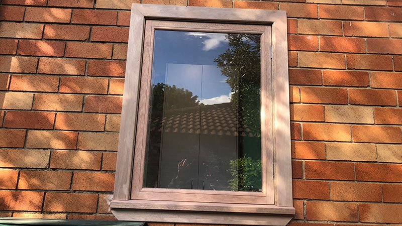Custom built and installed hardwood window