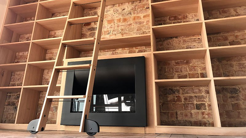 Bespoke sustainable Oak bookcase with library ladder