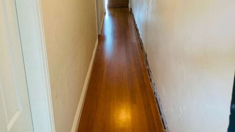 Wainscoting wall panelling to lower hallway wall
